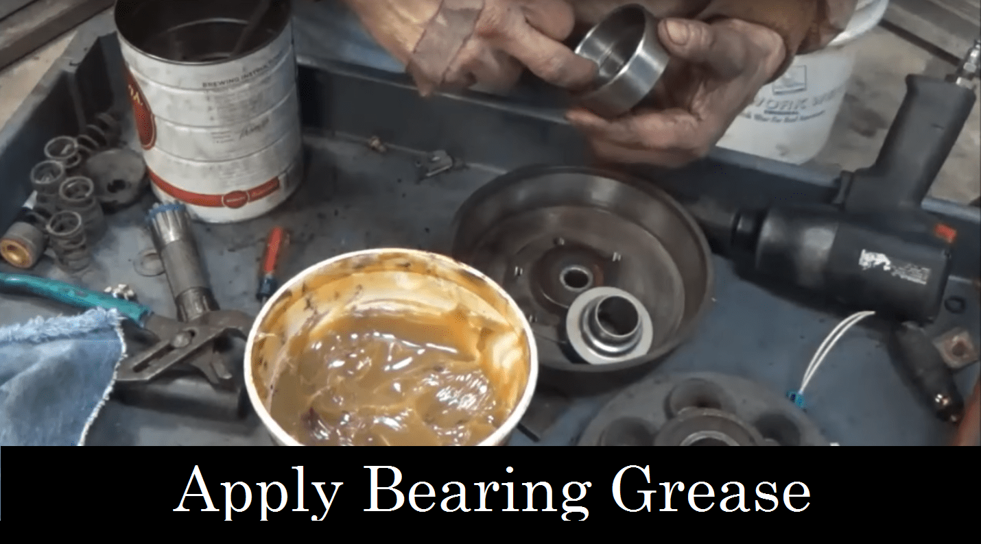 Applying bearing grease to the fan clutch for big truck repair