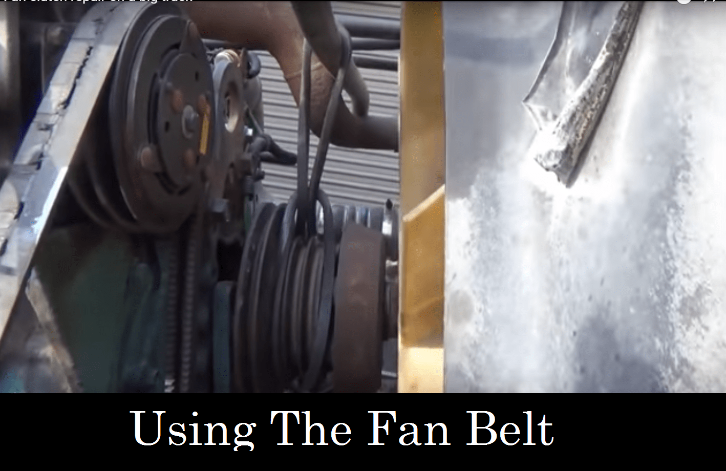Using the fan belt on a big truck repair