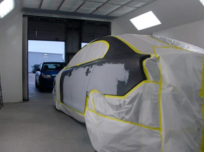 car being painted and covered with white plastic.