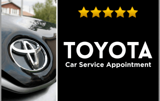toyotal logo is seen on a black car.